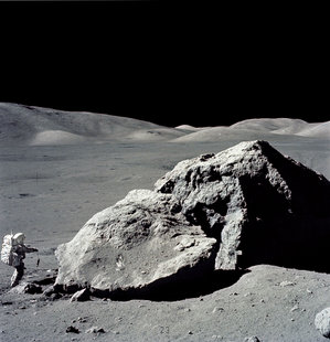 Astronaut Harrison Schmitt collecting rocks from the Moon during the Apollo XVII mission.